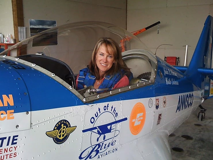 Author Cate Schultz flying